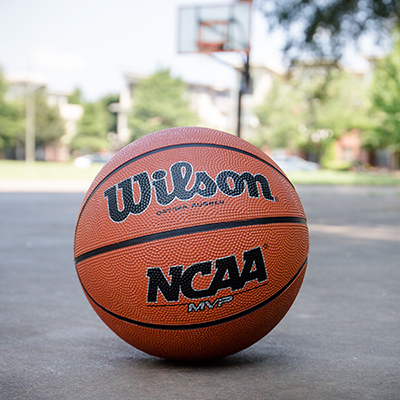 "WILSON<sup>&reg;</sup> NCAA<sup>&reg;</sup> Basketball - Boys, 12 years of age or older, regulation size 29.5"" basketball.  All surface cover."